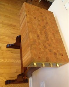 This is a hand crafted end grain butcher block designed for use or as furniture. Specs:  TOP Oak: white Oak perhaps. It is wood from a church pew that was being dismantled to be used for other purposes. Sanded to a smooth 600 grit and oiled with mineral oil (20 oz. absorbed). Food grade. LEGS Spanish Cedar: The legs are stained with Minwax Red Mahogany/ Jacobean mix which matches and blends the reds and browns of the two different wood species while also contrasting their light and dark ...