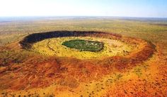 Wolfe Creek Crater is a well-preserved meteorite impact crater in Western Australia. It is accessed via the Tanami Road 150 km south of the town of Halls Creek. The crater is central to the Wolfe Creek Meteorite Crater National Park. Wolf Creek, Crater National Park, National Parks, Arizona, Western Australia, Australia Travel, Australia Photos, Melbourne Australia, Meteor Crater