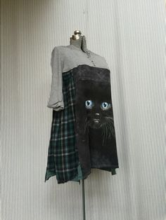 A personal favorite from my Etsy shop https://www.etsy.com/listing/467364460/upcycled-black-cat-halloween-tunic-art