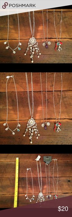 Express Necklaces Express necklaces, two new with tags! One on far left blue pink and white rhinestones. Second to left, white pearl-like beads and rhinestones. Second to right, semiprecious purple gemstone and pendants. Far right, whimsical mermaid with delicate coral and beads. All silver color, all great condition! Express Jewelry
