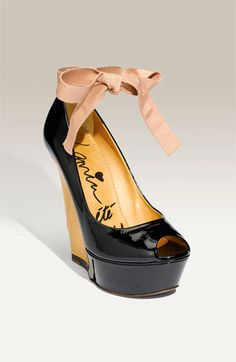 By Lanvin - I love bows and patent leather - wish the bow was black or pink though - yeh right like you'll ever see me in shoes like this - but one can still swoon!