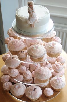 Cupcake tower with  buttercream cakes and fondant pink and ivory flower loveliness decorations