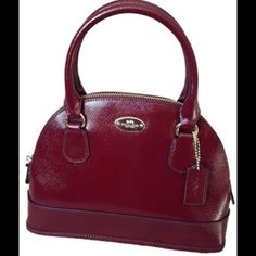 "Coach Patent Mini  Domed / Crossbody  Red Satchel AVAILABLE IN BALCK COLOR TOO.                                                                                    Coach Luxury Handbag /Patent Leather Patent crossgrain leather Inside zip pocket Zip-closure, fabric lining Handles with 3 1/2"" drop Long, detachable strap with 21 1/2"" drop for shoulder or crossbody wear 9 3/4"" (L) x 7"" (H) x 3"" (W) Coach Bags Crossbody Bags"