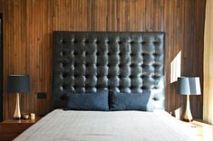 """The master bedroom's massive leather headboard was Thompson's idea and design. Tagged: Bedroom, Night Stands, Table Lighting, and Bed. Photo 5 of 9 in You Won't Be Calling This House a """"Man Cave"""". Browse inspirational photos of modern bedrooms. Green Headboard, Leather Headboard, King Headboard, Dream Bedroom, Master Bedroom, Bungalow, Interior Architecture, Interior Design, Headboard Designs"""