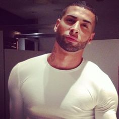 I love a man in tight long sleeves!!! And short scruff with those piercing eyes mmmmm