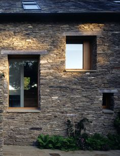 Devon stone at McLean Quinlan new build barn house. Concrete and timber lintels. Timber framed windows
