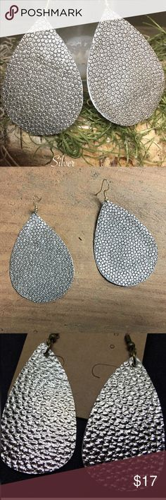 """Hand made Leather earrings Boutique Hand made textured leather earrings.  Light weight easy on the ear lobes  The perfect finishing touch to any outfit  Color sliver  Approx 3"""" precision cut Price is firm unless bundled Jewelry Earrings"""