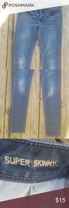 2 pairs skinny jeans American Eagle YMI Good condition. No stains or tears. The AE are size 2. The ymi are size 1. American Eagle Outfitters Jeans Skinny