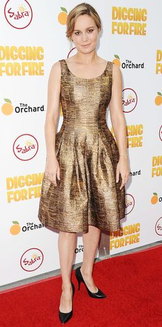 Brie Larson shimmered at the Los Angeles premiere of Digging For Fire in a gilded fit-and-flared dress, complete with Dana Rebecca Designs jewelry and black pumps.