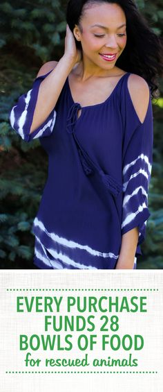 On sale now! Richly dyed indigo is broken up with bright white lines along the hem and sleeves on this flowy, open shouldered tunic! Topped with tassels on the neckline ties, giving your ensemble a truly royal feel.