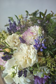 Dahlias, garden roses, ammi, sweet peas, fennel foliage, mint, clematis, and, of course, lavender joined forces with a few other flower friends to create a pastel pallet of sweet-smelling purples and creams. Lupin. Dahlia 'Eveline' would work.