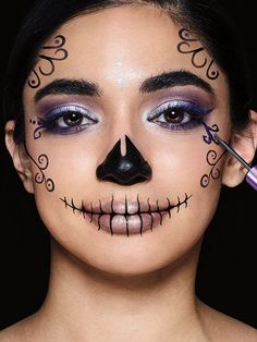 Learn how to do a sugar skull makeup look in this easy halloween makeup tutorial using Maybelline's metallic silver, purple & black liquid eyeliners.