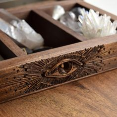 Please allow up to 5 days time for your All Seeing Eye box to leave our studio. Thank you.  Featuring an intricately carved all seeing eye accented in rays of light and stars, this beautifully detailed box would make the perfect storage tray for your crystals, tarot, runes, or other special treasures.  The all seeing eye is an ancient symbol that is rooted across many cultures. It is symbolic of a higher spiritual power and the awakened spiritual part within. It represents the opening of…