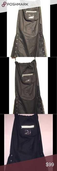 NWT Gothic Designer Cyber Maxi cargo skirt Goth NWT NEVER WORN from S.D.L. Totally hot Maxi skirt will fit 18-34 inch waist! Reflective strips, built in ID or badge case AND fanny/tummy pack! Check out the pics! Adjustable slide works fine, but cord looks a bit aged. Works fine. Open slits with netting inserts, eyelets. 39 long, hip 19 across, hemline 21 across NOT including expansive sides, pocket is appx 8.5x6.5x1.5 thick. Light yet substantial plastic w woven netting. KILLER! We are NOT…