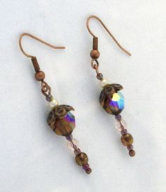 Fall-themed earrings in shades of dark topaz and purple. Made of Swarovski crystals and pearls, with seed beads and antiqued copper findings and earwires. {Keener Beaded Jewelry}