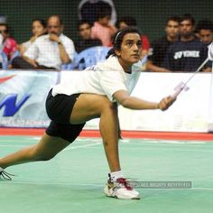 India's rising shuttler PV Sindhu settled for a bronze medal at the World Championships after suffering a straight-game defeat against world number three Ratchanok Inthanon in the semifinals of the prestigious event on Saturday. World Badminton Championship, World Championship, Basketball Court, Bronze, Club, Running, Number, Game, World Cup