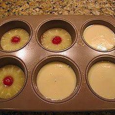 Mini Pineapple Upside Down Cakes  makes six large muffin size. Bake 350 15 min. Cake Ingredients: 2	eggs ⅔	C white sugar 4	Tbsp pineapple juice ⅔	C all purpose flour 1	tsp baking powder ¼	tsp salt Topping: ¼	cup butter (½ stick or 4 Tbsp) ⅔	C brown sugar 1	-can pineapple rings 6	-maraschino cherries