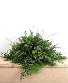 A beautiful casket spray of greenery. This display uses a mixture of seasonal tropical foliages. Casket Flowers, Funeral Flowers, Funeral Floral Arrangements, Flower Arrangements, Flowers For Men, David Flowers, Simple Flowers, Colorful Flowers, Funeral Caskets