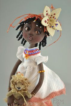 she is no barbie but i want her!    Flower leather for africana doll