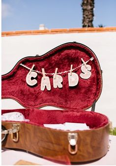 How great of an idea would this be if you used a piano bench....pen with the banner and then guests toss cards into the bench seat!!!!Rock and Roll and vintage , antique , whimsical wedding « Weddingbee Boards