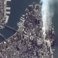 A satellite image of lower Manhattan shows smoke and ash rising from the site of the World Trade Center at 11:43 AM on September 12, 2001. The fires at Ground Zero continued to burn for 99 days after the attack -- a bleak reminder, day and night, of the thousands who lost their lives, and the countless millions more who lived, but whose lives were forever transformed.
