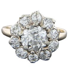 English antique 14KY gold 1.80 CTW diamond ring in floral design with a 1.15 carat old European cut diamond center surrounded by ten diamonds at 0.65 CTW.