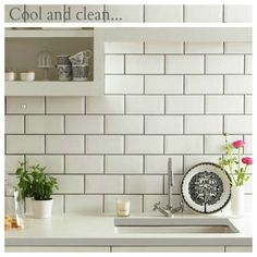 White subway tile + gray grout. Not black... Too stark.