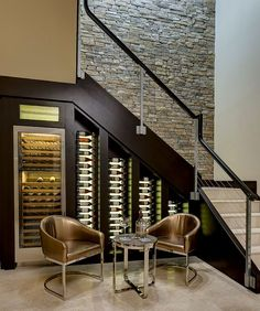 Custom-built cooler with LED lighting for the wine cellar under stairs [Design: Bill Cook Luxury Homes]