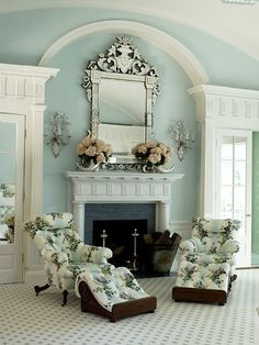 Turquoise sitting area with fireplace in a master bedroom by Anthony Baratta.