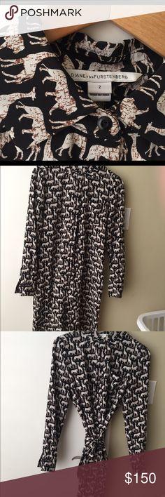 DVF SILK SHIRT DRESS NWOT Super cute. Size 2. Silk shirt dress with silk belt. Has Lions and Giraffes on it. Diane von Furstenberg Dresses Long Sleeve
