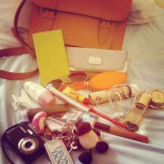 """@Kristina Mann's photo: """"@Glossybox UK #myglossyhandbag this is my usual haul, everything incase of an emergency and probably the biggest bunch of keyrings to ever excist! The Elnet and Carmex have got to be the essentials but i like my luxurys too."""""""