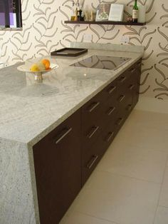 New Kashmir White granite countertop with waterfall. Visit globalgranite.com for your natural stone needs.