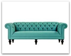 tufted sofa - in a gorgeous green fabric. Must find a space to put this!