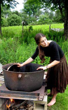 Working the black walnut vat over an open fire. Dye Workshops in Vermont, summer 2012. via marshfield school of weaving
