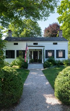 The house dates to 1830 and sits behind a neat, square row of hedges in Claverack, a few minutes' drive from Hudson.