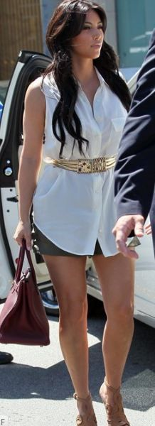 Who made Kim Kardashian's nude sandals, white button down sleeveless top, and red handbag that she wore in Los Angeles on August 17, 2011? Shoes – Azzedine Alaia  Shirt – Equipment Signature  Purse – Hermes