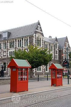 Buy or license direct from the photographer this stunning image of : Art Centre In Christchurch , New Zealand With English Style Red Telephone Booths . The Beautiful Country, Beautiful Places, New Zealand Holidays, Christchurch New Zealand, Living In New Zealand, Telephone Booth, New Zealand South Island, Kiwiana, Amazing Buildings