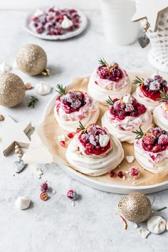 Mini meringues topped with light whipped cream cranberry sauce and sparkling sugared cranberries. It doesnt get more festive than this. By Emma Duckworth Bakes Small Food Processor, Food Processor Recipes, Mini Meringues, Mini Pavlova, Sugared Cranberries, Meringue Cookies, Cheesecake, Christmas Desserts, Christmas Cupcakes