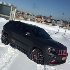 Jeep SRT8 wrapped deep matte black with matte pink highlights and calipers