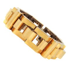 Stylish Retro Yellow Gold Bracelet   From a unique collection of vintage retro bracelets at https://www.1stdibs.com/jewelry/bracelets/retro-bracelets/