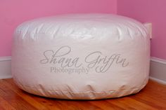 I made one of these, super easy. Vinyl is frequently on sale at JoAnn's. A beanbag for a newborn shoot is very helpful, especially out of vinyl because messes wash right off the surface.