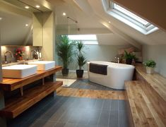 Dashing bathroom with slanted ceiling and skylight Are you planning to remodel your Bathroom with Attic Design ? Look at our Beautiful Bathroom Attic Design Ideas & Pictures for more inspiration.