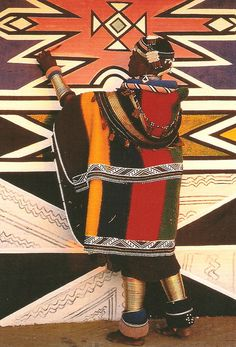 Africa |  Sights and Sounds.  A woman painting an Ndebele home.    Alternatively known as the Matabele, the Ndebele are a Southern African ethnic group that are said to have branched off from the larger Zulu tribe after Mzililikazi, a former general in King Shaka's army, split from the Zulu Kingdom around the early 1820s.