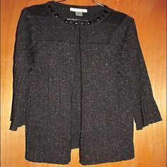 """WD NY Black Sparkly Pleated Cardigan Sz S WD NY sparkly black pleated sheer open cardigan with 3/4 length sleeves - size small.  Has beaded collar.  80% viscose, 20% lurex. Buttons at neck. .  In excellent condition.  Measurements: Chest:  16""""  across the front Waist:  15""""  across the front Total Length:  22"""" Arm Length:  15.5"""" WD NY Sweaters Cardigans"""