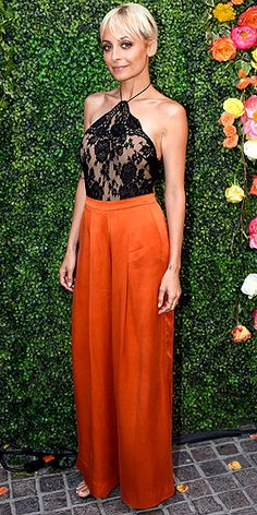Last Night's Look: Love It or Leave It? Vote Now! | NICOLE RICHIE  | in a black lace halter top and wide-leg orange pants at an event celebrating the season two premiere of her VH1 show, Candidly Nicole, in Los Angeles.