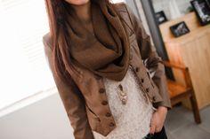 Brown jacket. Brown scarf.