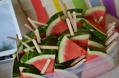 "watermelon popsicles (my kids LOVE this... I added a paper bowl underneath and through the stick for extra ""leak"" protection... :) )"