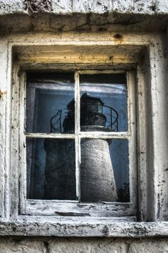 Lighthouse reflection on the window glass. #Lighthouse