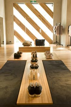Α wooden showroom by Kata Inc, a company in Tokyo | shoe rack (FIND MORE οn: www.pinterest.com/AnkApin/stores)