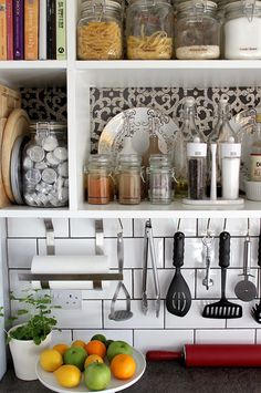 gilded plates for a little sparkle •clear labels on glass containers • utensils hung for counter space - Swoon Worthy